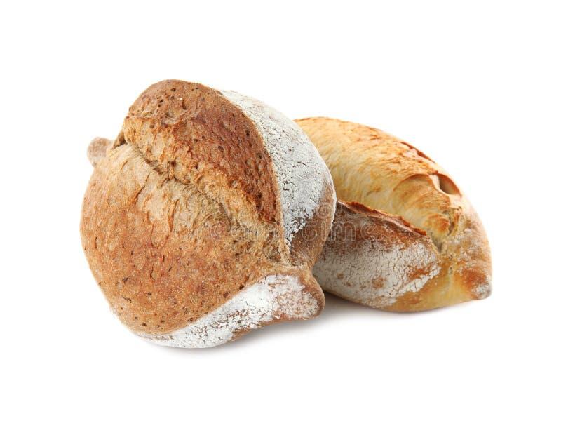 Pains de pain frais sur le blanc image libre de droits