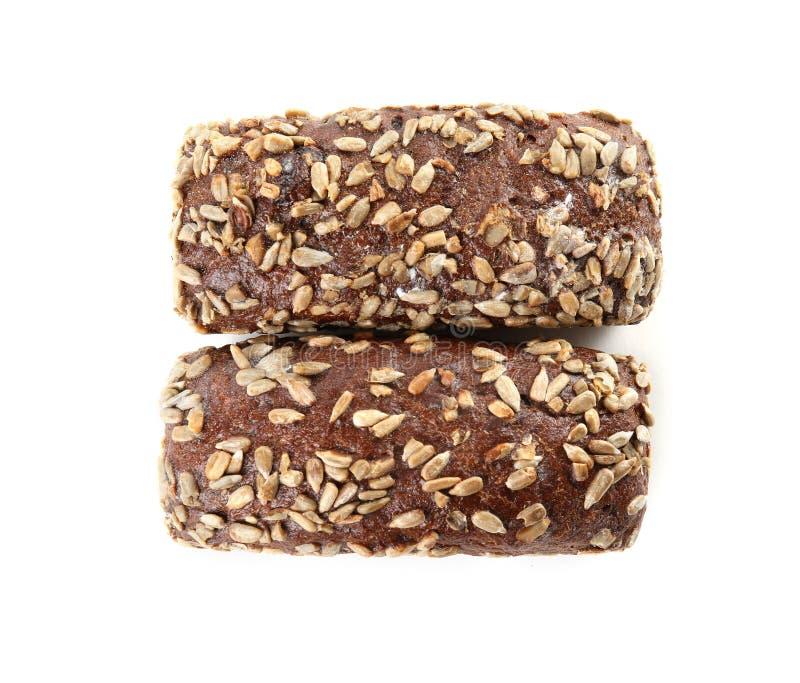 Pains de pain de seigle avec des graines de tournesol d'isolement sur le blanc photo stock