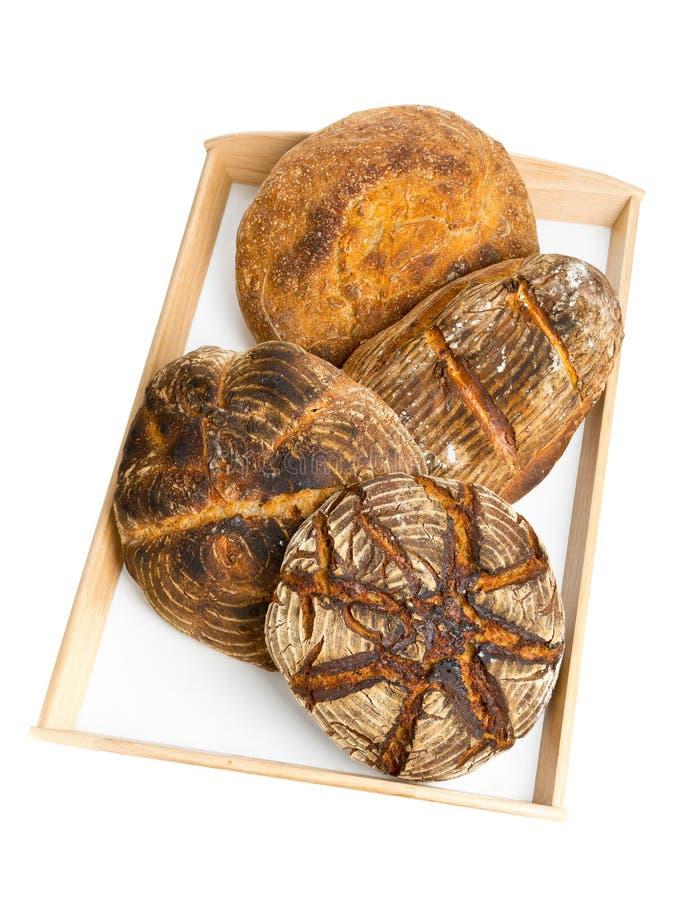 Pains de pain sur le plateau de portion photos libres de droits