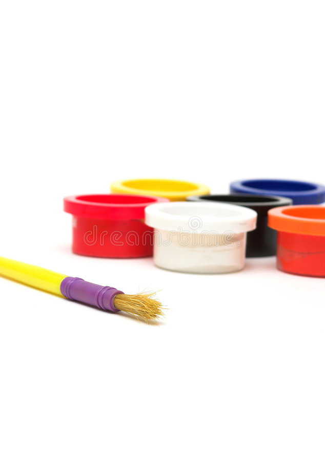 Paint. Pots and brush against white stock images