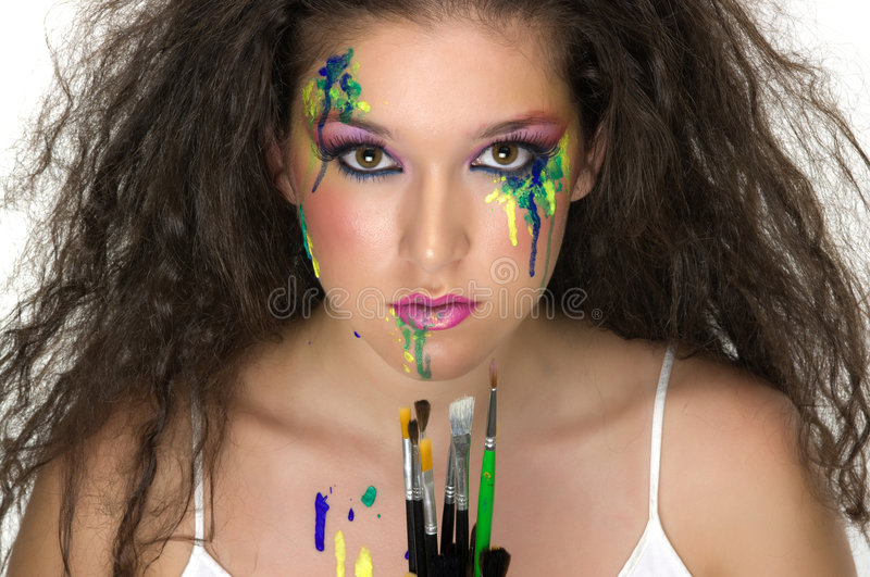 Paint. Er girl with beautiful make up royalty free stock photos