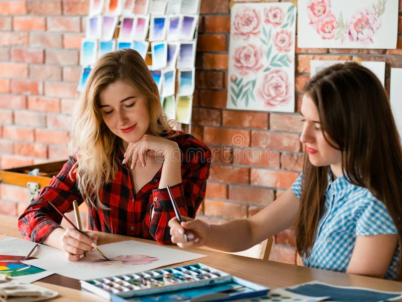 Paint art class teacher watercolor technique learn. Painting art classes teacher. watercolor techniques mastering. explanation communication and learning concept stock photo