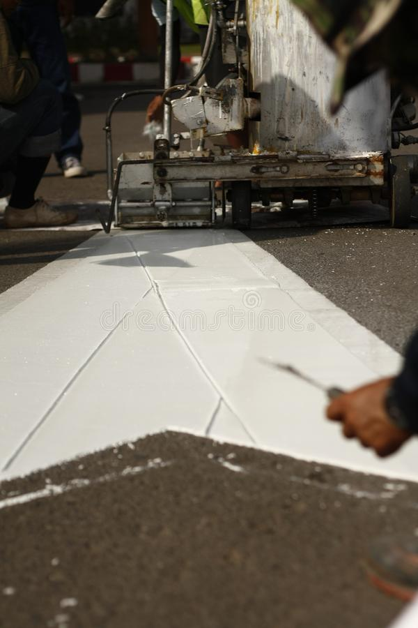 Paint being applied to a new road. White paint being applied to a new road surface royalty free stock photo