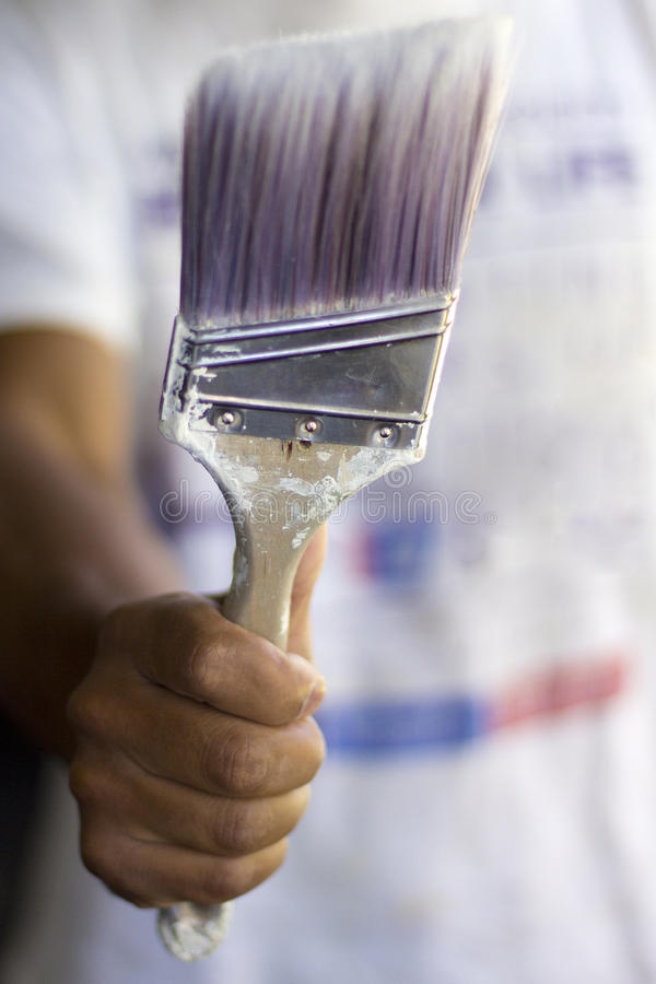 Paint Brush. Painter holding his favorite paint brush royalty free stock photo