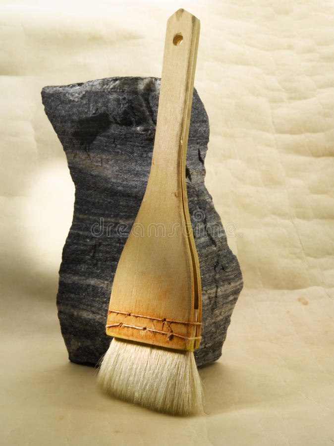 Paint brush. Still of a handmade paint brush against a stone royalty free stock photos