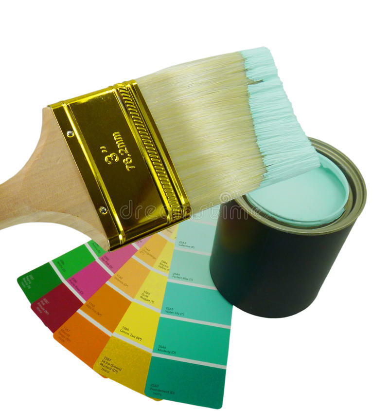 Paint brush with aqua paint. A wooden paint brush dipped in aqua blue paint hoovering over an open can of paint and a rainbow of paint chips isolated on white royalty free stock photography