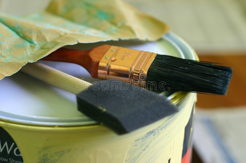 Paint Brush and Can. Paint brush, paint can, sandpaper stock photography
