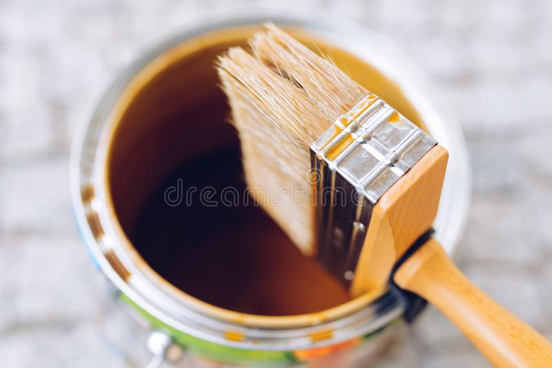 Paint brush on the can. Top view. House renovation, home improve royalty free stock photography