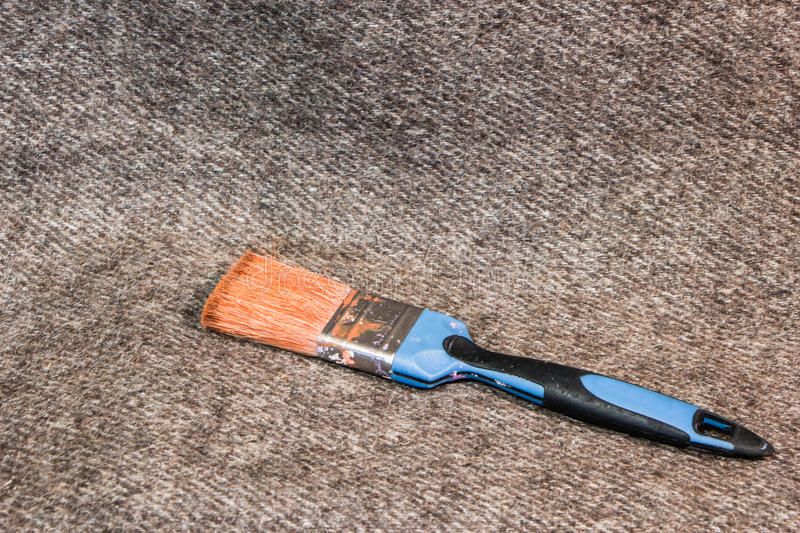 Paint brush on a canvas background royalty free stock photos