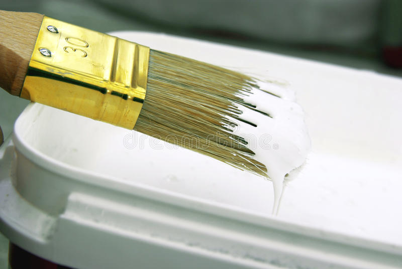 Paint brush close-up. Close-up image of a paint brush with white paint stock photos