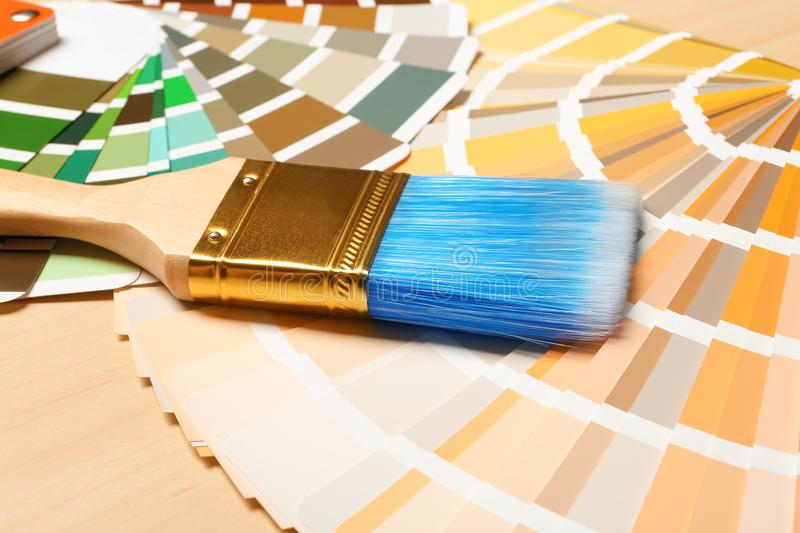 Paint brush and color palettes on table. Closeup stock photo