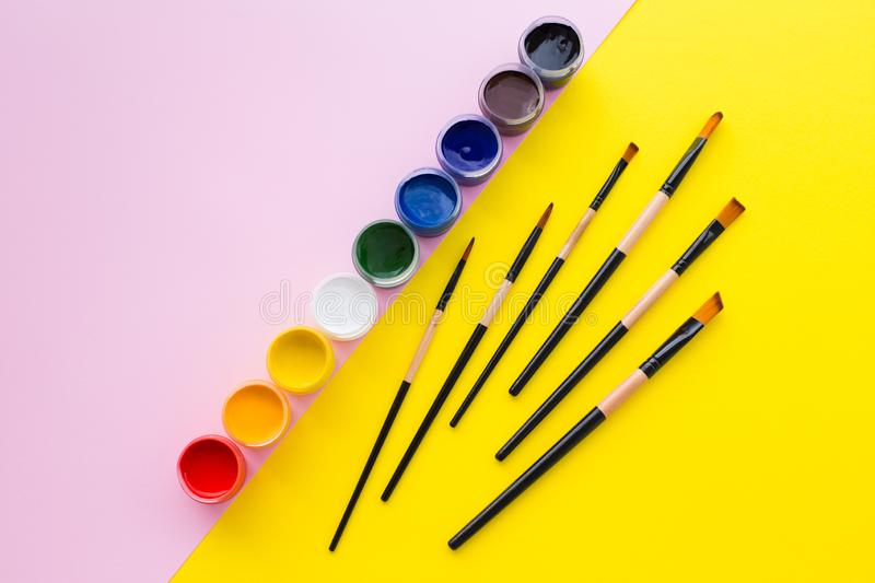 Paint, brush, pink and yellow background. royalty free stock photos