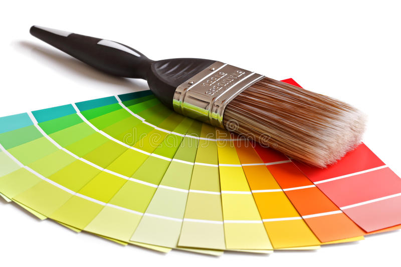 Paint brush and swatches. Coloured swatches and paintbrush on white background stock photography