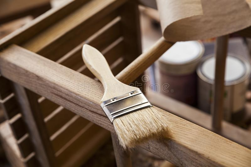 Paint brush. And varnish can stock photo