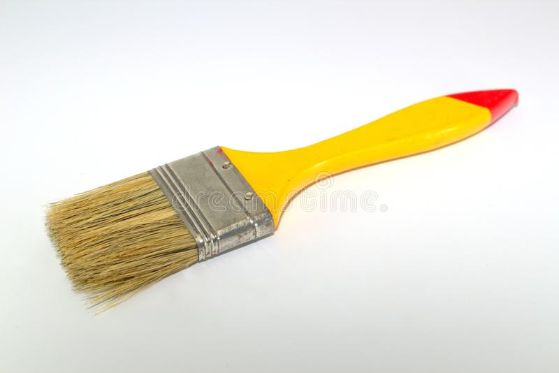Paint brush width 2 inches with a yellow handle on a white background. Close-up royalty free stock images