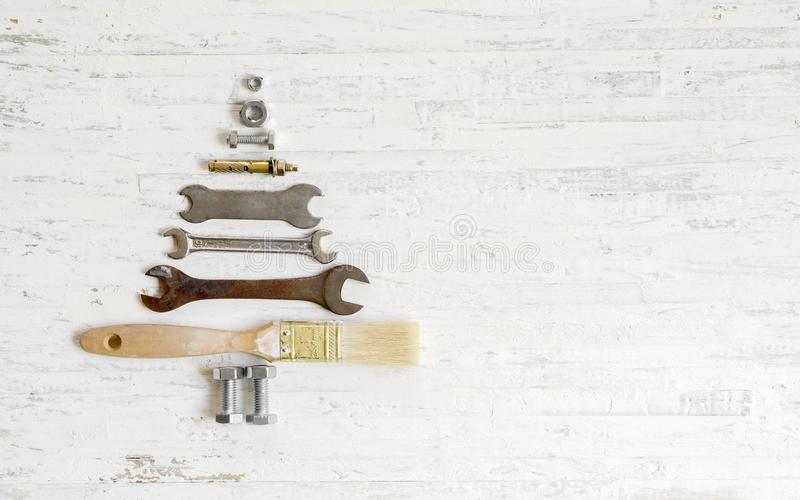 Paint brush wrench, nuts and bolts decorated as christmas tree o royalty free stock photos