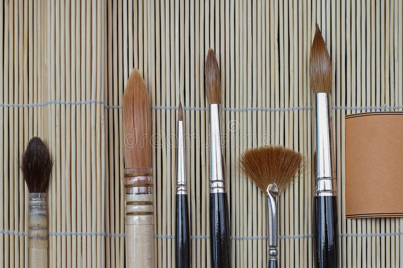 Paint brushes. Various artistic paint brushes for fine art royalty free stock image