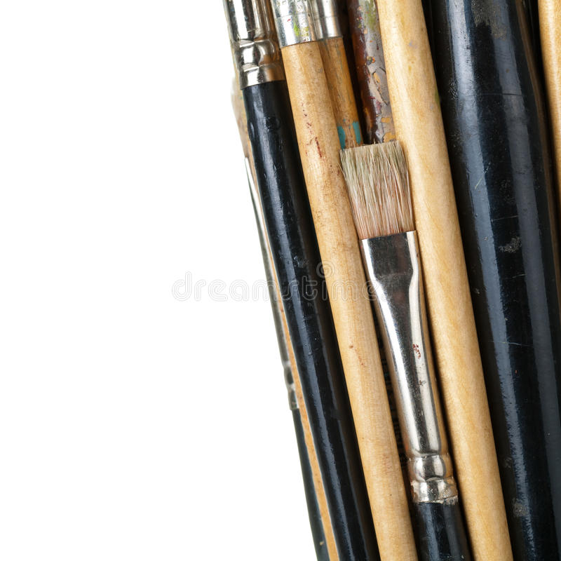 Paint Brushes. Isolated on white background, macro shot with empty room for text stock image