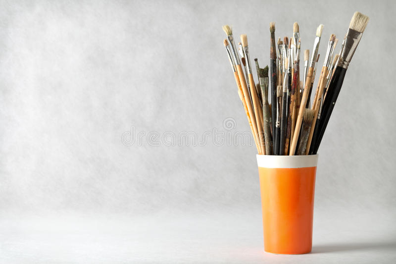 Paint Brushes. Art paint brushes in cup with empty room for text royalty free stock images