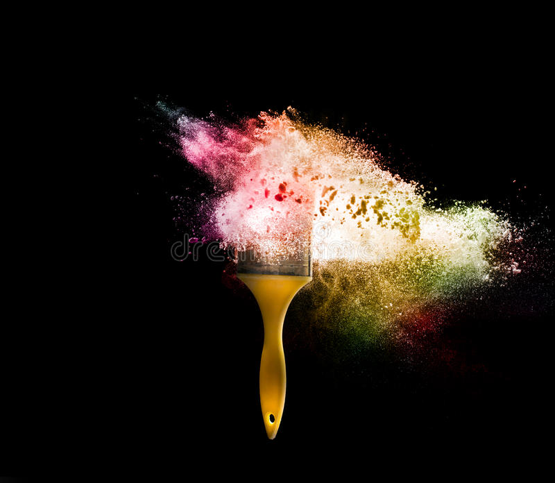 paint brushes with abstract powder color explosion isolated on b royalty free stock photography