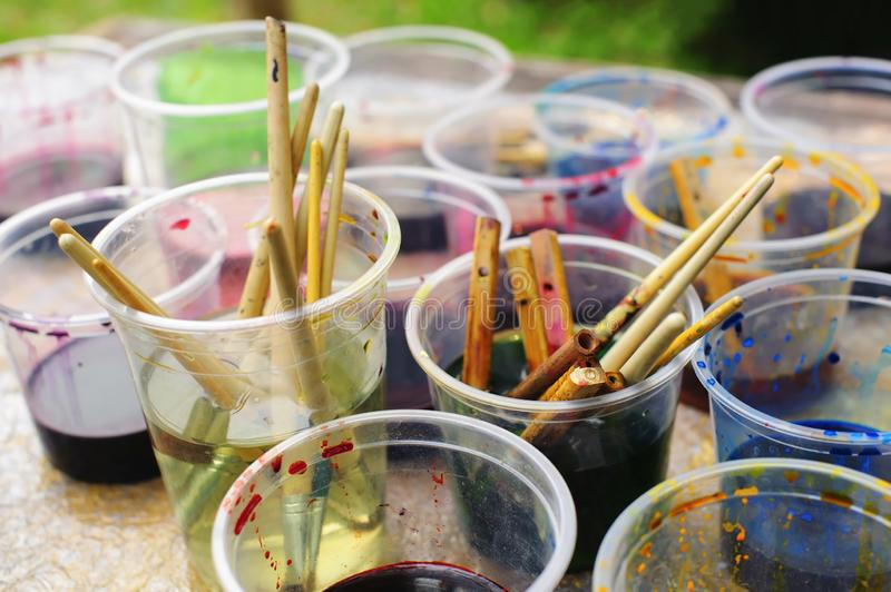 Paint and brushes, close up royalty free stock photography