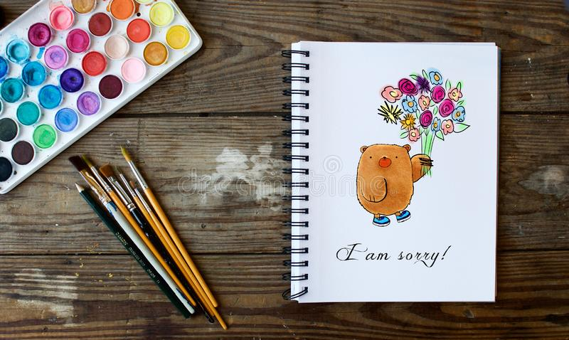 Notebook with watercolor bear and flower bouquet stock images
