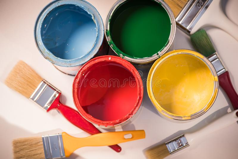 Paint brushes and opened paint cans royalty free stock images