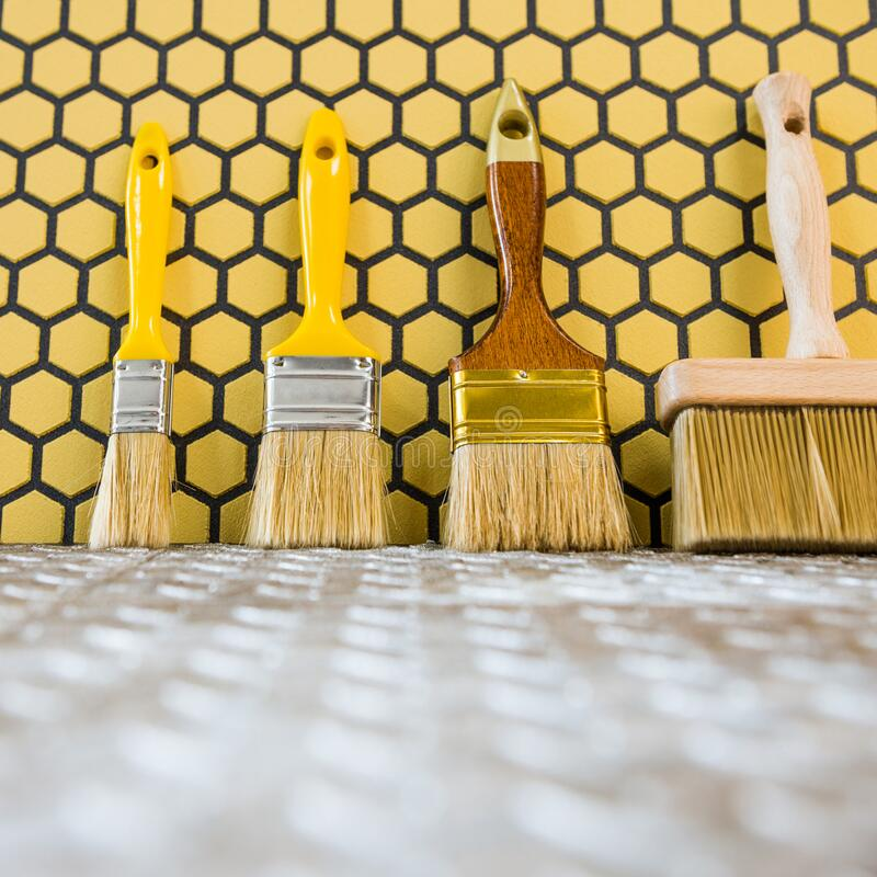 Paint brushes over metallic surface stock image