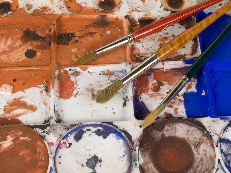 Paint brushes and palette. With a lot of colours royalty free stock photos