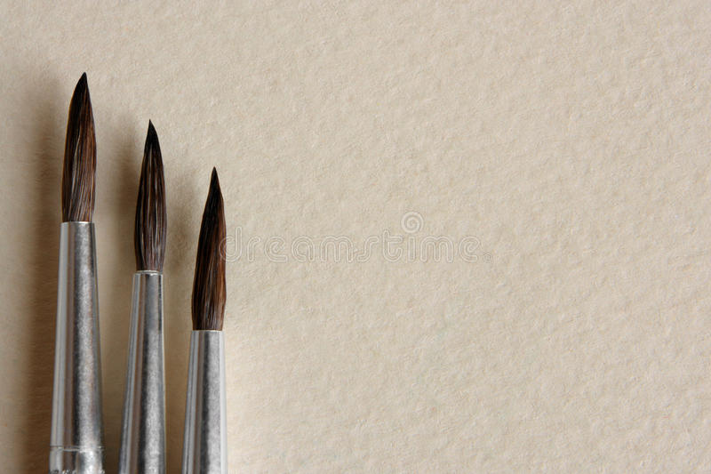Download Paint Brushes On Papers Background Royalty Free Stock Photography - Image: 14072417
