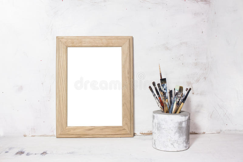 Paint brushes and photo frame royalty free stock photo