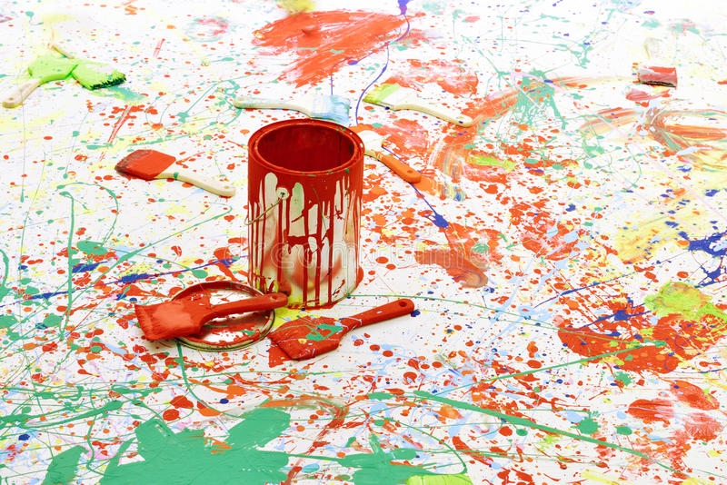 Paint bucket and brush. The paint bucket and brush are on the board royalty free stock image