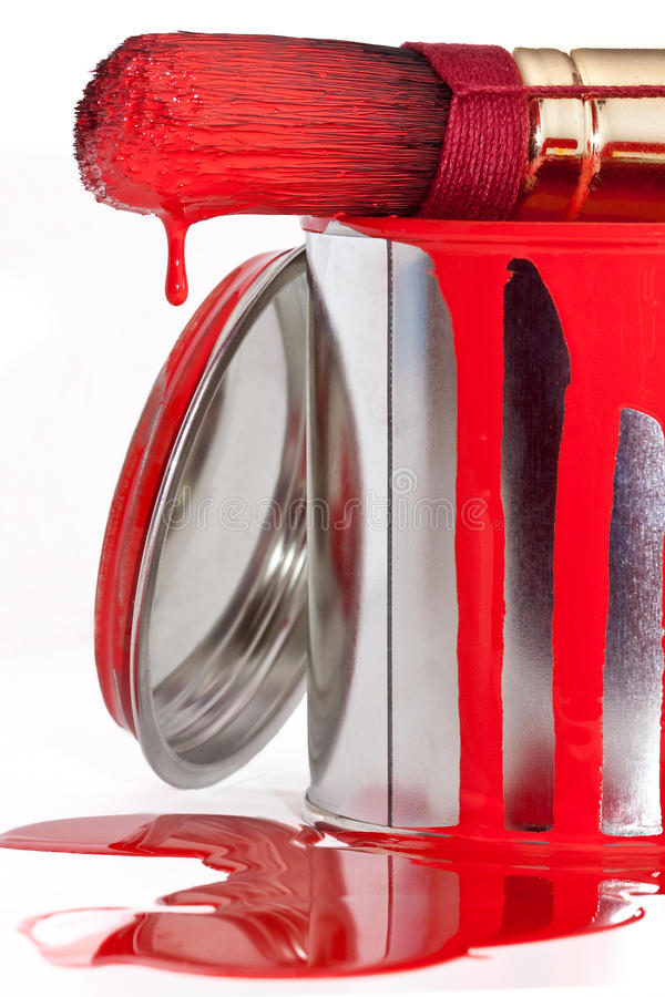 Paint can with dripping brush isolated on white. Background stock photo