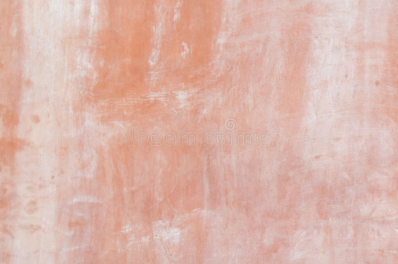 Paint cement wall. Old orange painted cement wall royalty free stock image