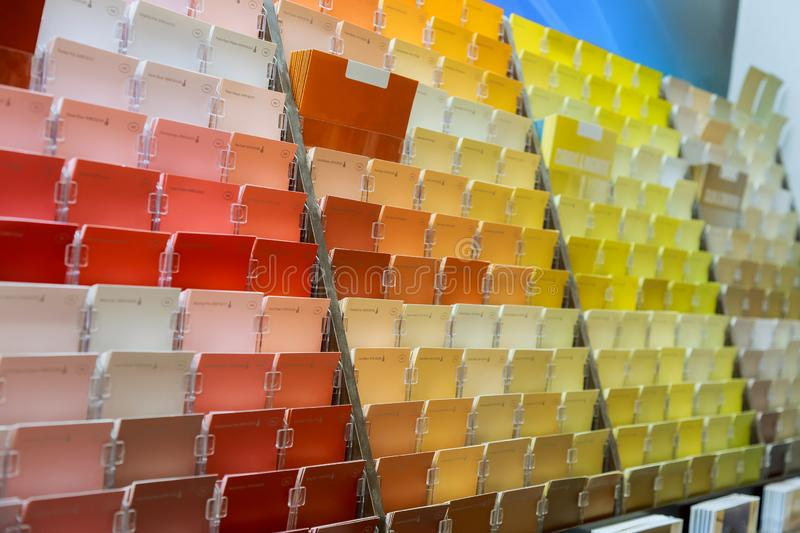 Paint color swatches on display in a painting store. Paint color swatches on display in a painting store shop for interior designers and customers stock image
