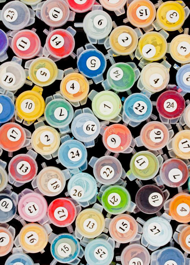 Paint containers for painting by numbers royalty free stock photo