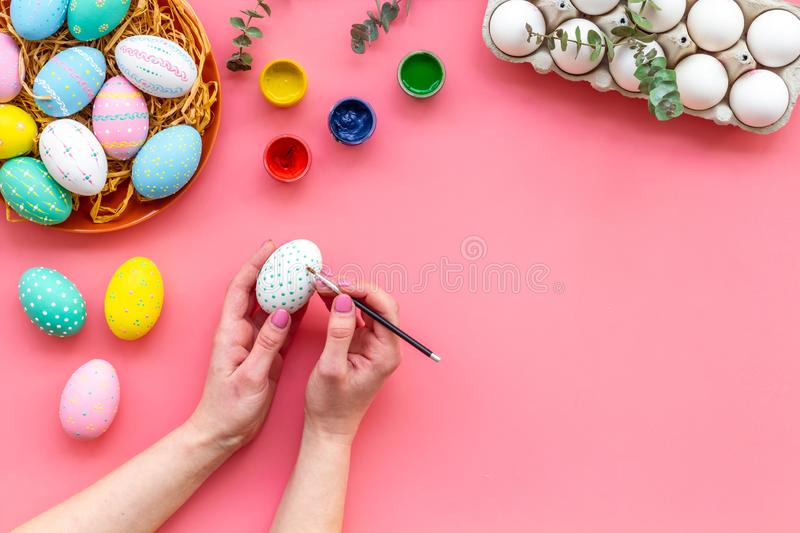 Paint eggs for Easter celebration on pink background top view mock up royalty free stock photos