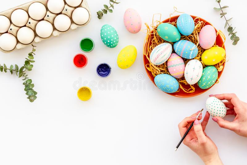 Paint eggs for Easter celebration on white background top view copy space royalty free stock images