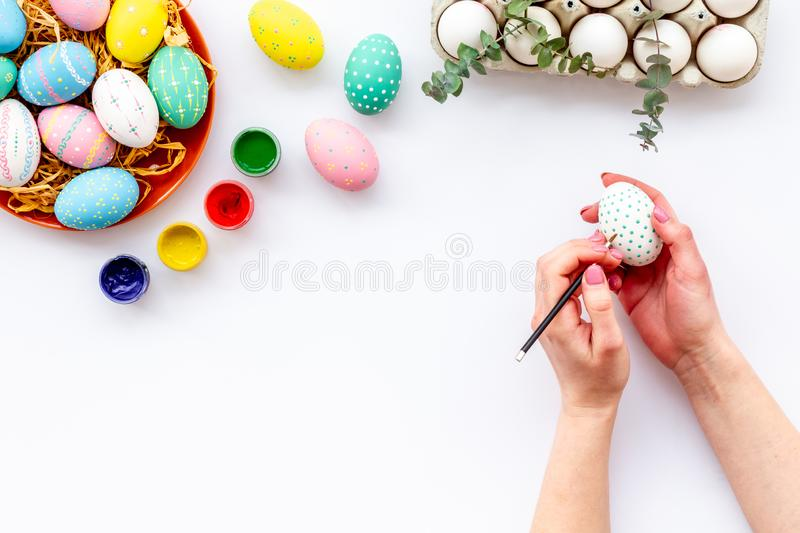 Paint eggs for Easter celebration on white background top view copy space stock image