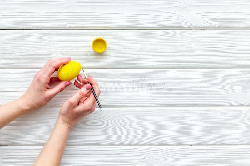 Paint eggs for Easter celebration on white wooden background top view mock up royalty free stock image