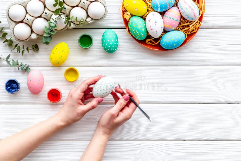 Paint eggs for Easter celebration on white wooden background top view mock up royalty free stock images