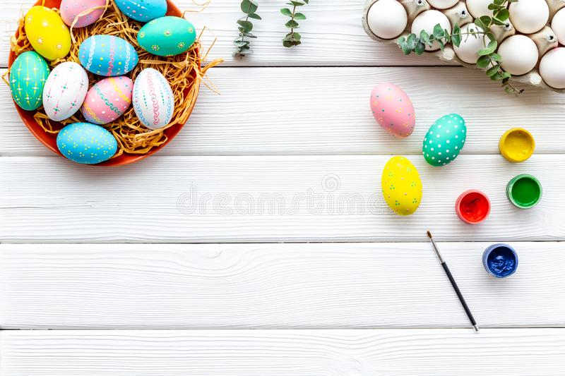 Paint eggs for Easter celebration on white wooden background top view mock up stock image