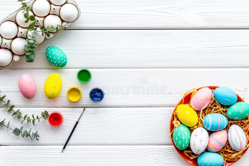 Paint eggs for Easter celebration on white wooden background top view mock up royalty free stock photography
