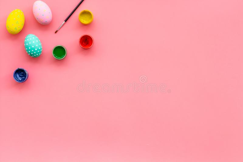 Paint eggs for Easter celebration on pink background top view mock up royalty free stock images