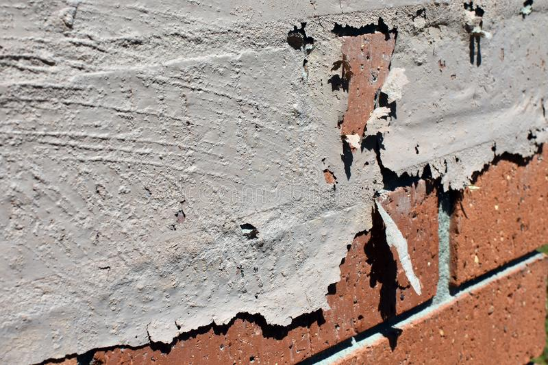 Paint flaking off a red brick wall royalty free stock photos