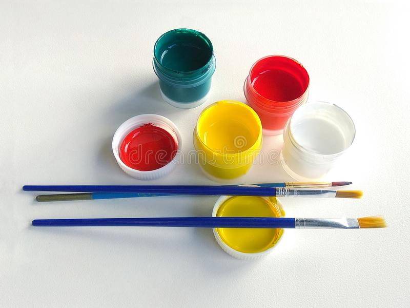 Paint gouache container white background brushes. royalty free stock photography