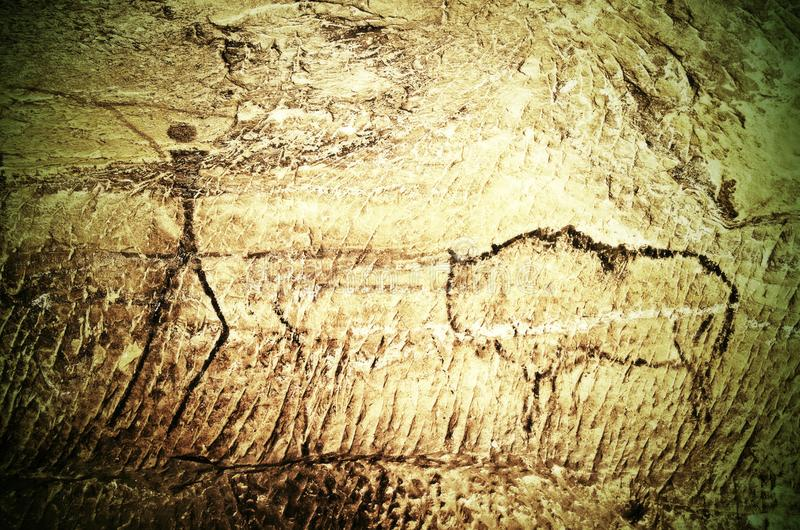 Paint of human hunting on sandstone wall, copy of prehistoric picture. Black carbon abstract children art in cave. Paint of human hunting on sandstone wall, copy stock image