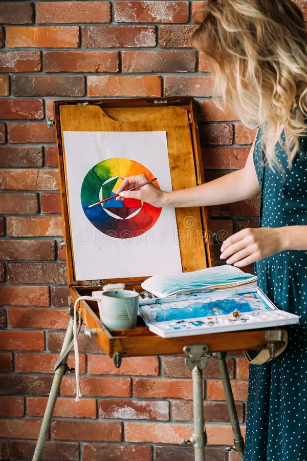 Paint lesson art class skill learn draw color wheel. Painting lessons and art classes. girl learning to draw a color wheel. skill improvement and watercolor stock photography