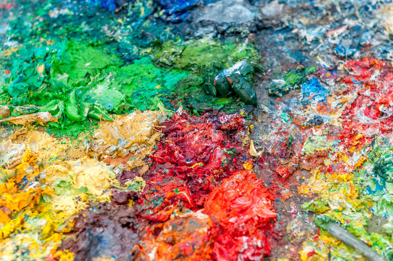 Paint on palette full of colors stock photos