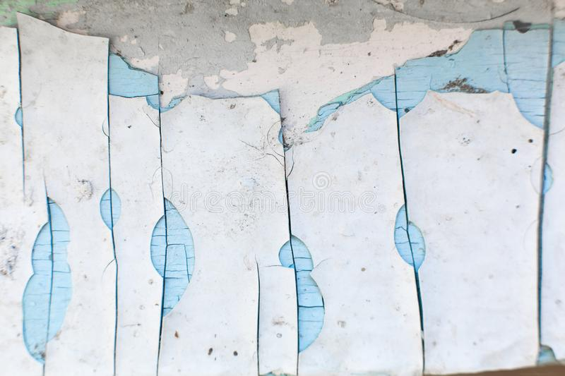 Paint peels off the wall. Mill painting with a large number of layers of old paint.  royalty free stock photos